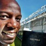 prison fence bible and prisoner